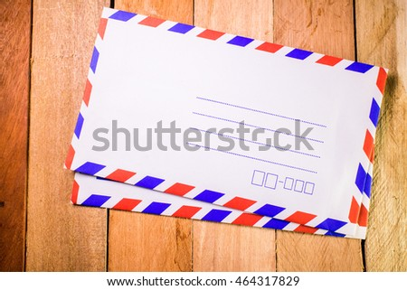 Mail on wooden background