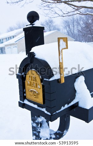 Mailbox covered in snow - stock photo