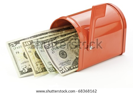 mailbox filled with money from refund, rebate, or wages - stock photo