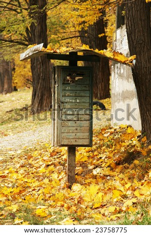 mailbox in the yellow leaves - stock photo