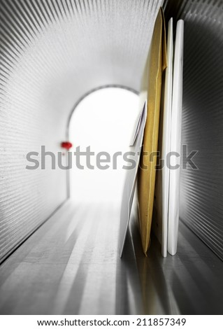 Mailbox inside Metallic mailbox on white background - stock photo