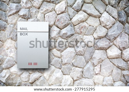 Mailbox on the rock wall background - stock photo