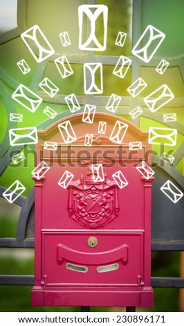 Mailbox with letter icons exploding on glowing green background - stock photo