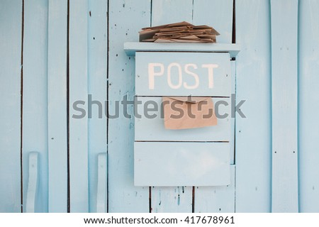 mailbox with letters in vintage style on wooden blue background - stock photo