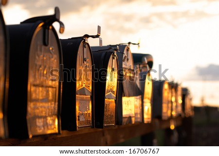 Mailboxes in row at sunset