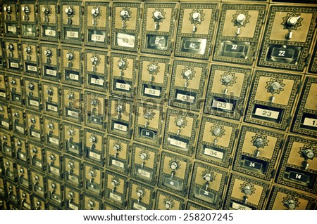 Mailboxes lined up in a post office. - stock photo
