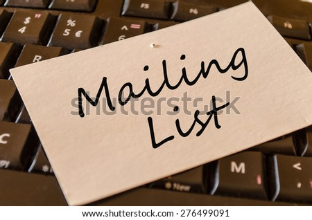Mailing List Concept on black keyboard - stock photo