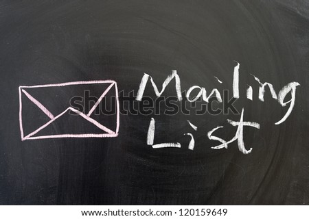 Mailing list words and symbol on the blackboard - stock photo
