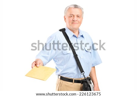 Mailman handing an envelope towards the camera isolated on white background - stock photo