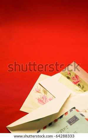 Mails on red backgrounds with blank space for text - stock photo