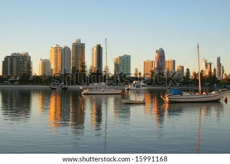 Main Beach and Surfers Paradise Gold Coast Australia at sunrise seen North from Southport across the Nerang River. - stock photo