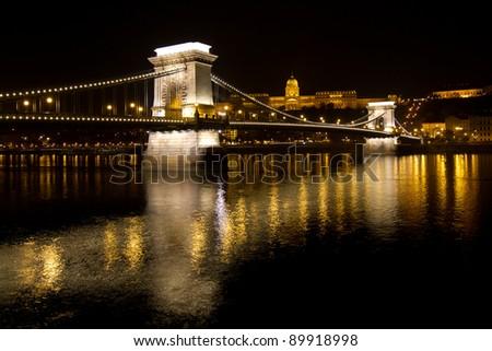 Main bridge by night in Budapest, Hungary - stock photo