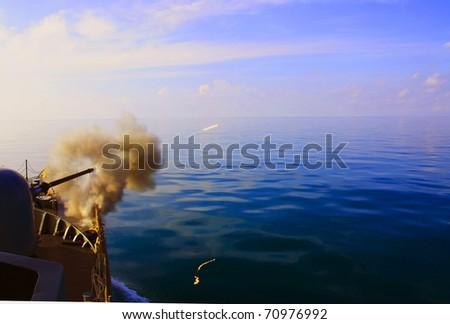 Main cannon on board battleship firing - stock photo