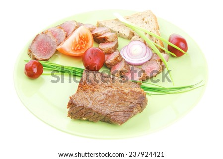main course : roast red meat slices served on green plate with tomatoes and sprouts isolated on white background - stock photo