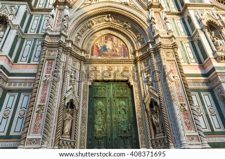 Main door of Florence Cathedral (Duomo) Santa Maria del Fiore in Florencein the rays of sunset, Italy - stock photo
