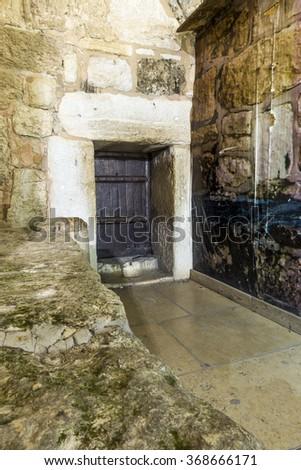 Main door to Church of Nativity, Bethlehem, Palestinian Autonomy, Middle East - stock photo