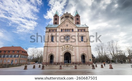 Main entrance, facade and cobbled square of the famous UNESCO world heritage Speyer Cathedral, Germany - stock photo