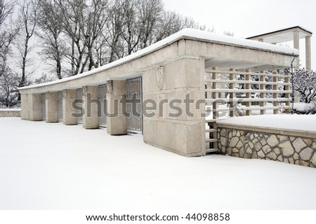 Main entrance of the War Pole cemetery covered by snow. San Lazzaro, Bologna, Italy.