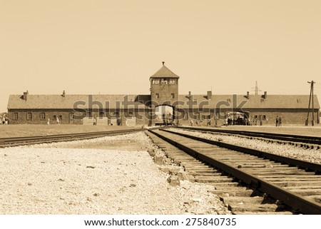 Main entrance to Auschwitz Birkenau Concentration Camp, sepia photo, World War II, Second World War,WW2, Poland - stock photo