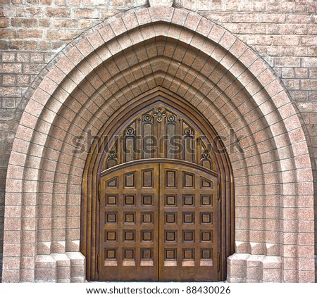 Main entrance to catolic church in gothic style - stock photo