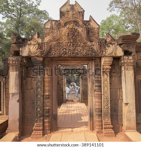 Main entrance to the Citadel of the Women, Banteay Srei, Cambodia, AD 987 with an ornate and intricately carved gateway of pink sandstone in the jungle