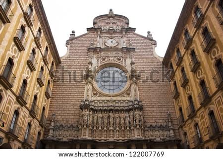Main facade of Santa Maria de Montserrat monastery. Catalonia, Spain - stock photo