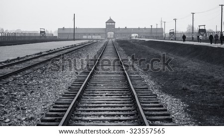 Main Gate and Railroad to Nazi Concentration Camp of Auschwitz Birkenau in Poland - stock photo