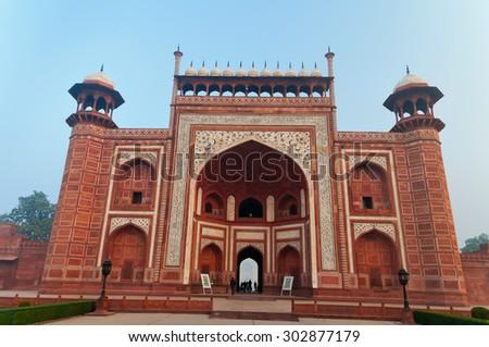 Main Gate to Taj Mahal in the fog in the early morning . Agra. India - stock photo
