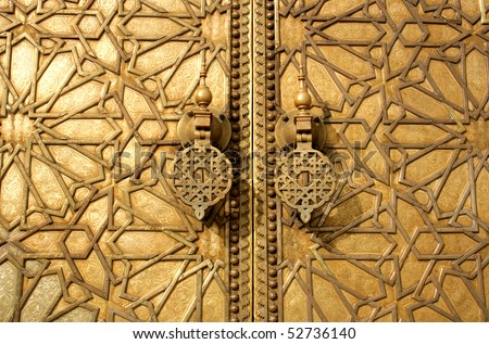 main golden gates of royal palace in marrakesh, morocco - stock photo