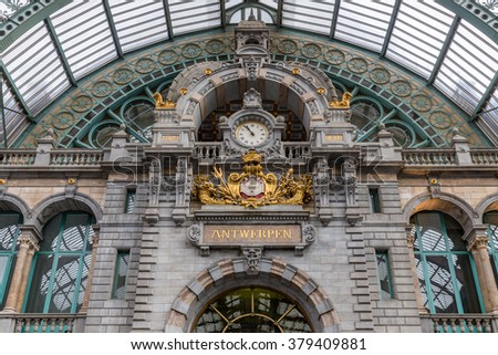 Main hall with clock and plate with Dutch city name 'Antwerpen' of famous art deco station of Antwerp, Belgium - stock photo