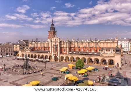 Main market square, cloth hall and town hall tower seen from above, Krakow, Poland - stock photo
