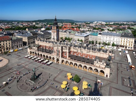 Main Market Square (Rynek), old cloth hall (Sukiennice) and town hall tower in Cracow (Krakow), Poland. Aerial view - stock photo