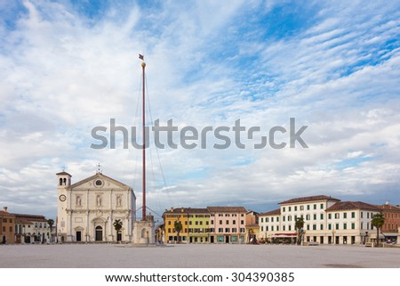 Main square and cathedral of Palmanova, town and comune in northeastern Italy. The town is an excellent example of star fort of the Late Renaissance, built up by the Venetians in 1593. - stock photo
