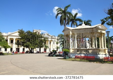 Main Square in Santa Clara, Cuba. Palm trees. - stock photo