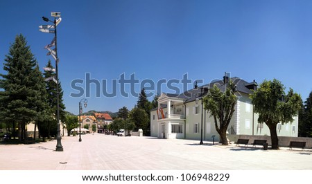 Main square of Cetinje ( ?????? / Cetinje) a town and Old Royal Capital of Montenegro. Panorama - stock photo