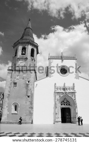Main square of medieval town Tomar (Portugal). Aged photo. Black and white. - stock photo