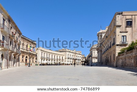 Main square Piazza del Duomo in Ortigia, town of Siracusa Italy with cathedral and other building