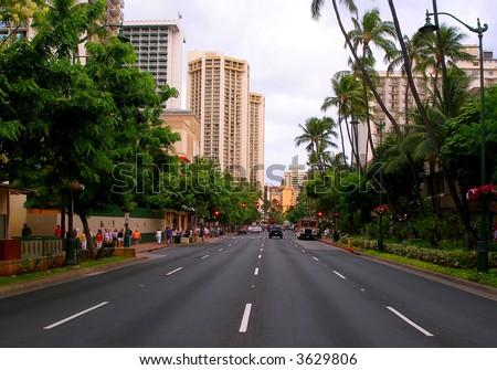 Main street in Waikiki Hawaii at sunset - stock photo