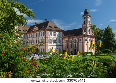 "MAINAU, GERMANY - SEPTEMBER 12, 2015: Island Mainau  a ""flowering island"" notable for its parks and gardens, and is palced in Boden Lake.  Baroque Castle of the Teutonic Order was built in 1739â??1746"