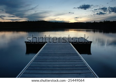 maine dock along lake - stock photo
