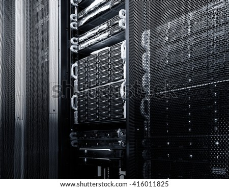 mainframe disk storage in the data center - stock photo