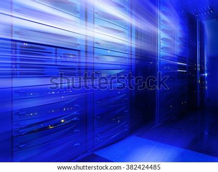 Mainframe stack in the server room blue blur - stock photo