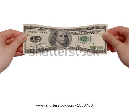 Mains étirant la facture $100 sur le fond blanc - stock photo
