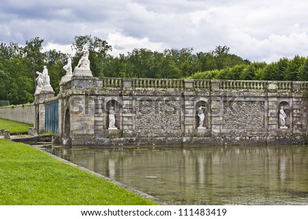Mainsail near the Grand Canal in the park of Fontainebleau. Palace of Fontainebleau - one of largest royal chateaux in France (55 km from Paris), UNESCO World Heritage Site. - stock photo
