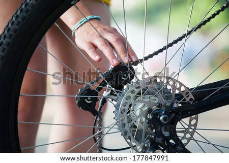 Maintenance and repairs on the chain and chain rings of a mountain bike - stock photo