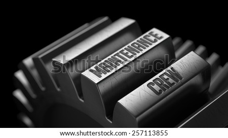Maintenance Crew on the Metal Gears on Black Background.  - stock photo