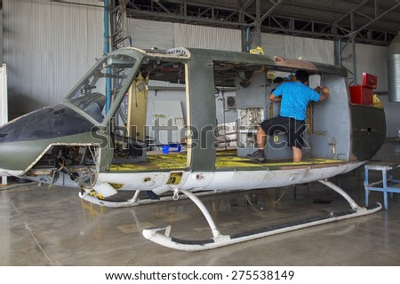 Maintenance of the helicopter with parts dissembled  - stock photo