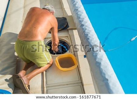 Maintenance of the pumping system of a pool - stock photo