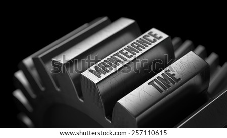 Maintenance Time on the Metal Gears on Black Background.  - stock photo