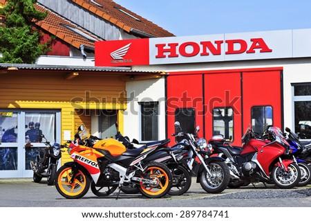 Honda motorcycle stock images royalty free images for Honda motor company stock